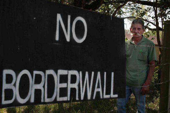 Erik Garza from Granjeno Texas has mixed feelings about the border wall in his garden
