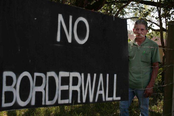 Erik Garza from Granjeno Texas has mixed feelings about the border wall in his garden